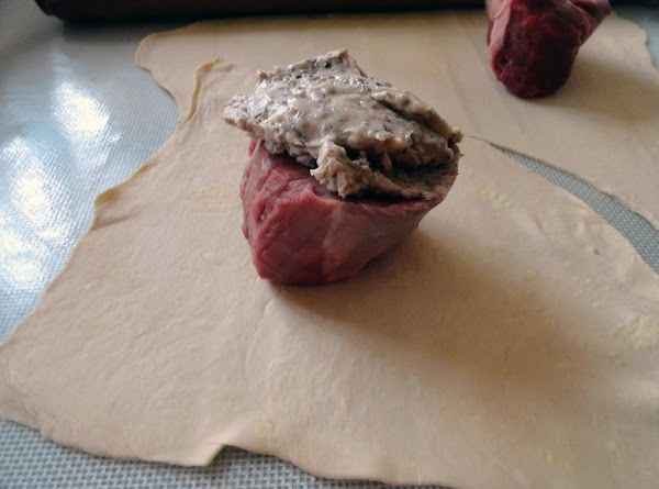 Spread the pate on top of each filet. Wrap the filets in puff pastry,...