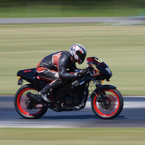 Racing bike by Aram Becker - Sports & Fitness Motorsports ( panning, bike, motorbike, motor, pann, track, blurr, sport, fast, racetrack )