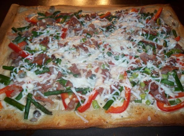 Bake the pizza for about 7 minutes and then add the rest of your...