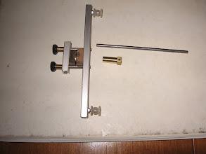 Photo: Le serrage n'étant pas suffisant : bague fixée sur l'axe pour augmenter le diamêtre