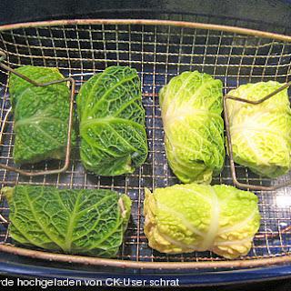 Schellfisch in Lachsfarce mit Wirsingmantel an Linsen und Pilzen in einer Sahnesauce