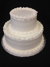 Photo: Simple wedding cake with top and bottom borders around each tier with smooth sides.