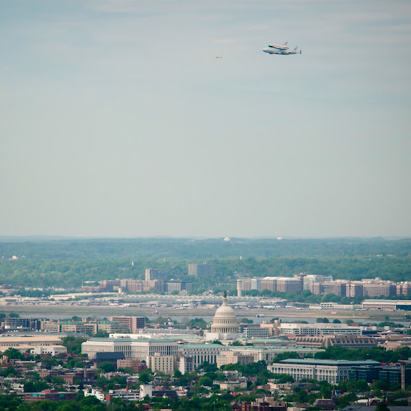 Photo: Space shuttle Discovery, mounted atop a NASA 747 Shuttle Carrier Aircraft (SCA) flies near the U.S. Capitol, Tuesday, April 17, 2012, in Washington. Discovery, the first orbiter retired from NASA's shuttle fleet, completed 39 missions, spent 365 days in space, orbited the Earth 5,830 times, and traveled 148,221,675 miles. NASA will transfer Discovery to the National Air and Space Museum to begin its new mission to commemorate past achievements in space and to educate and inspire future generations of explorers. Photo Credit: (NASA/Bill Ingalls)
