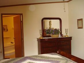 Photo: Master bedroom with en suite master bath.