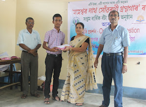 Photo: Sri Suraj Pratim Bora, a library member is being facilitated for securing 15th position in Assam 10th Board exam