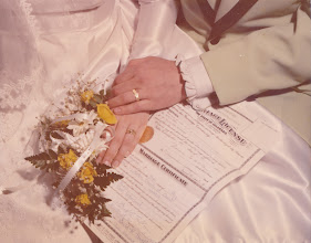 Photo: Phyllis and David rings, bouquet, wedding license.
