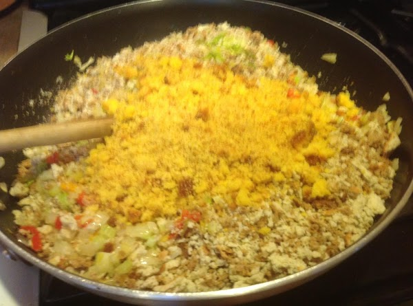Now add corn bread and chicken broth & stir till mixed together.