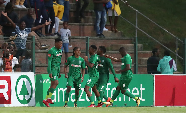AmaZulu striker Mhlengi Cele celebrates with teammates after scoring during the Absa Premiership match against Mamelodi Sundowns at King Zwelithini Stadium in Umlazi, south-west of Durban, March 2 2018.