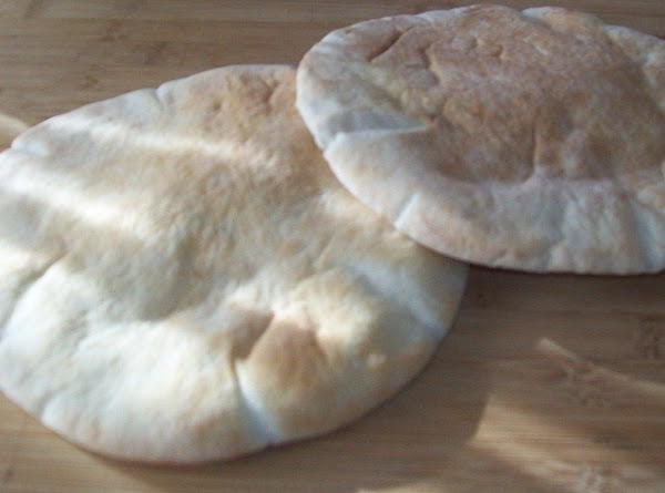Get the pitas warm in the oven 300 degrees', about 5 minutes, remove them...