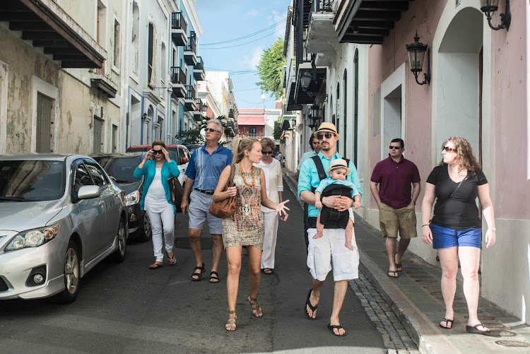 A guide and visitors on an Old San Juan Walk & Taste Tour from Spoon Food Tours.
