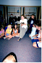 """Photo: Sheri teaching her class with her snake """"Q"""" as an educational prop."""
