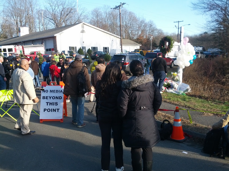 Photo: No Media signs are in several places around this community in grief.