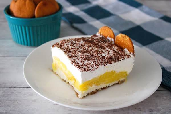 A Banana Pudding Square On A Plate.