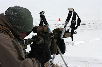 Photo: Soldiers from A Co., 3rd Battalion, 10th Special Forces Group (Airborne), shoot at a nearby range during weather exposure training here, Jan. 22. The Green Berets from Fort Carson spent a day at the range learning to shoot from skis and snow shoes. (Photo by Staff Sgt. Michael R. Noggle)