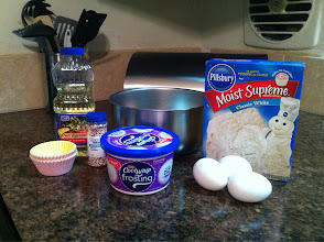 Photo: Getting ready to make the princess cupcakes! The little one could hardly stand the wait!