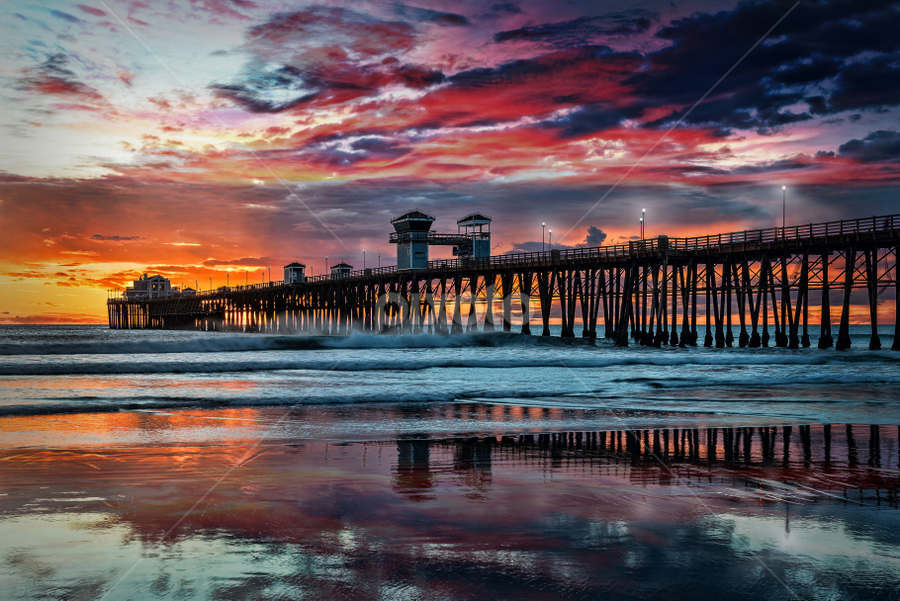 Oceanside Pier Dusk by Alan Crosthwaite - Buildings & Architecture Bridges & Suspended Structures ( san diego backgrounds, beach sunsets, colorful, oceanside pier, reflections, ocean sunsets, tourism, beach, travel, dusk, coastal, silhouetted, destination, san diego, san diego sunsets, piers, sunset, pier, wooden piers )