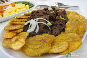 Griot with fried plantains (taso vyann bèf ak bannann peze)