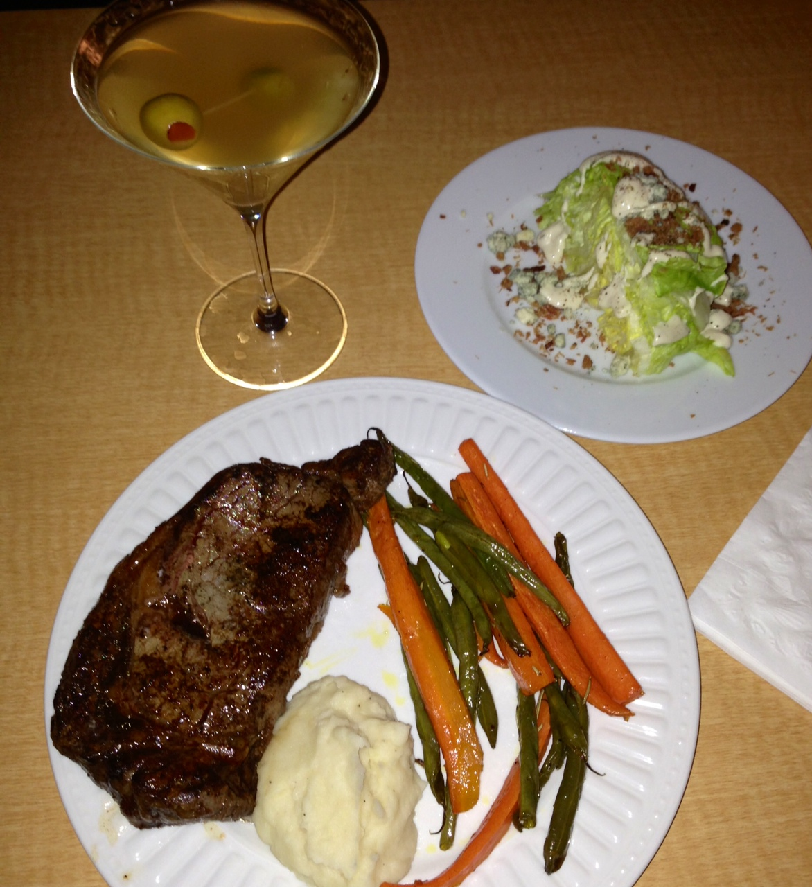 Photo: Home-cooked ribeye with roasted carrots & green beans, mashed potatoes, mini wedge salad. And a dirty martini, of course. Who needs to go out to a steakhouse?? ;)