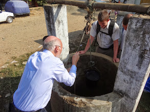 Photo: Drawing living water from the village well in Jeluki.