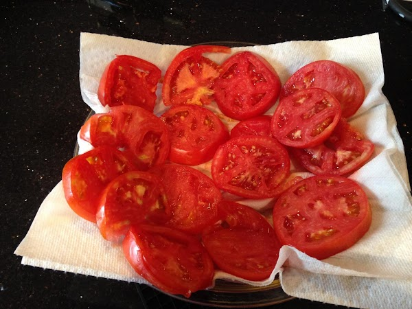 PLACE  SLICD TOMATOES ON PAPER TOWELS FOR A FEW MIN. TO SOAK UP...