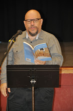 Photo: Jason Zions reads his poetry.