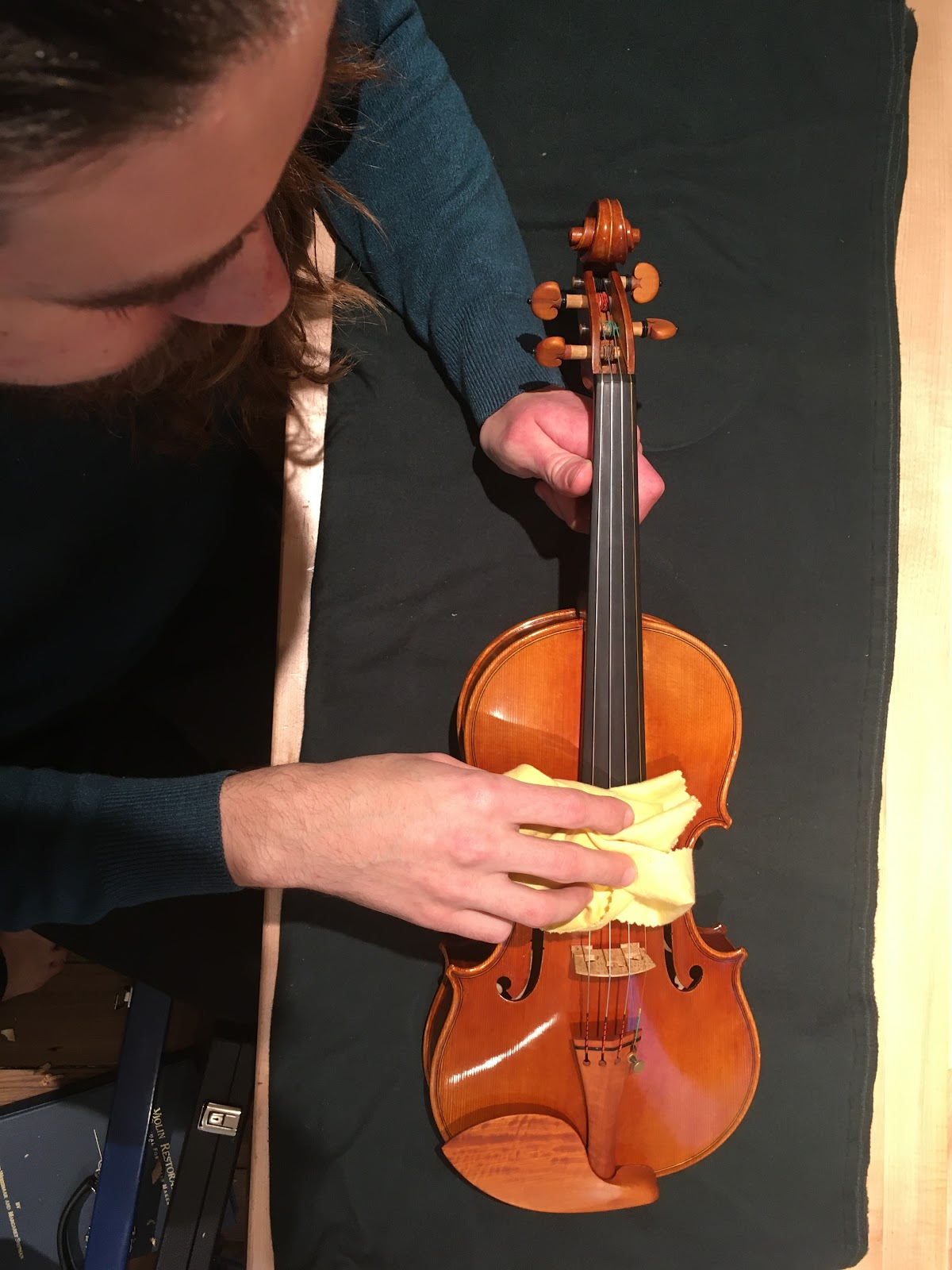 Cleaning Strings with towel