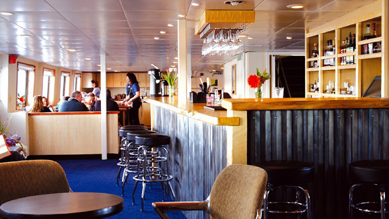 The bar and dining room aboard the Wilderness Discoverer.