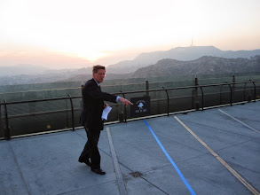 Photo: Sunset ceremony - Dr. E.C. Krupp, observatory directory, leads a sunset ceremony on the West Observation Terrace as part of the festivities.