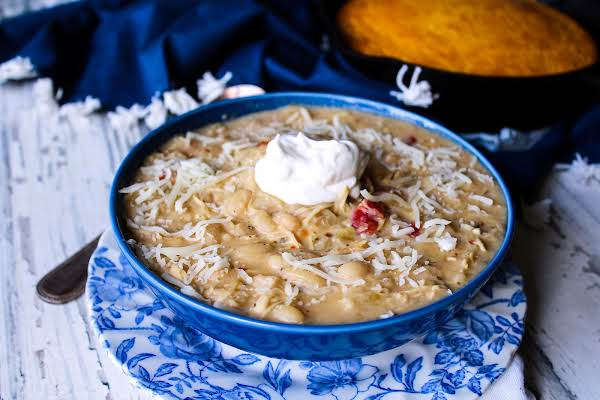 A Bowl Of After Thanksgiving White Chili With Sour Cream And Mozzarella Cheese.