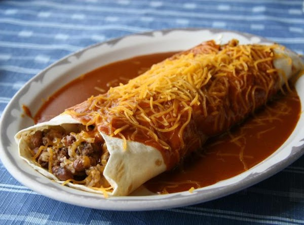 preheat oven to 350 brown hamburger meat drain fat in large pot add enchilada...