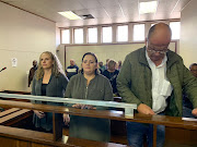 From left to right: Tharina Human, 27, Laetitia Nel, 40, and Pieter van Zyl, 50, are accused, along with a fourth person, of snatching Amy'Leigh de Jager from her mother's arms outside her school in Vanderbijlpark on September 2.