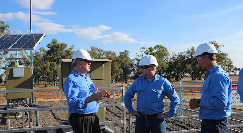 Santos Managing Director and Chief Executive Officer, Kevin Gallagher, centre, with general manager Energy NSW Peter Mitchley, left, and manager of Narrabri operations Todd Dunn at a pilot natural gas well on private farm land near Narrabri in March last year.