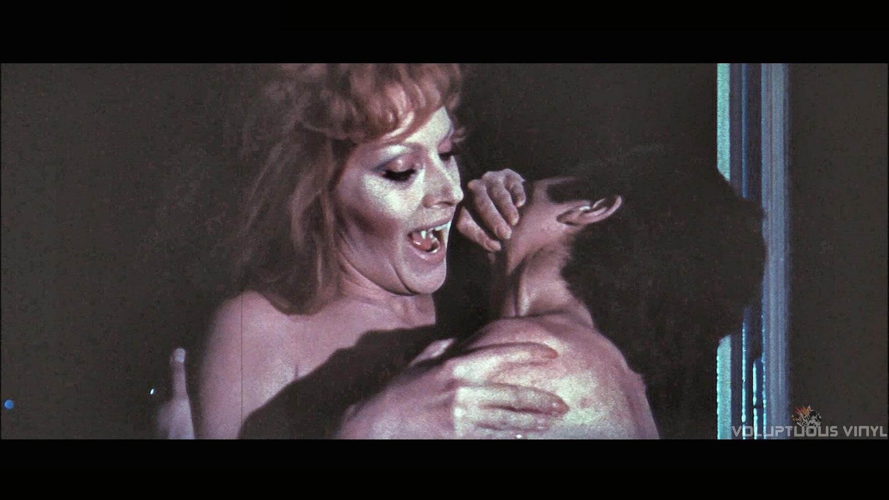 Helga Line taking a bite, in The Vampires Night Orgy