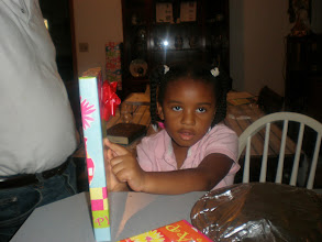 "Photo: Kaleya says ""it's a book!"""