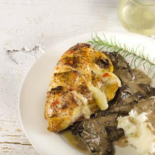 Pepper Jelly-Glazed & Jack-Stuffed Chicken with Mushroom Madeira and Creole Horseradish Mashed Potatoes.