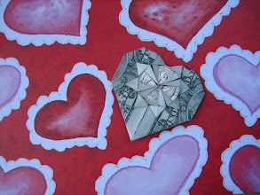 Photo: Model: Change Of Heart;  Creator: Kathleen Weller;  Folder: William Sattler;  1 dollar plus a Quarter coin;  Source: Bay Area Rapid Folders BARF http://www.barf.cc/diagrams/PDF_diagrams/pdf_diagrams.html