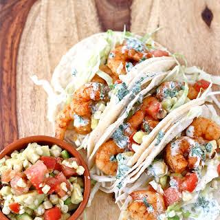 Shrimp Tacos with Avocado Corn Salsa and Herb Crema.