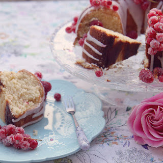 Lemon Drizzle Bundt Cake With Sugared Raspberries And Redcurrants.