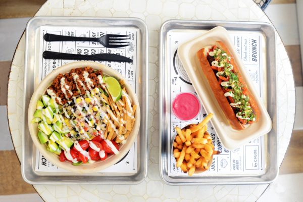 The quinoa taco salad, sweet potato fries and vegan hotdog. Photo: Angelina Jolin.