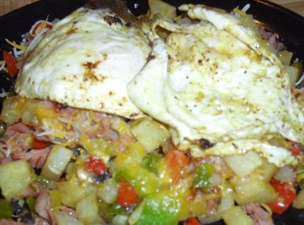 Cook eggs by way of choice and top the finished skillet.  Enjoy