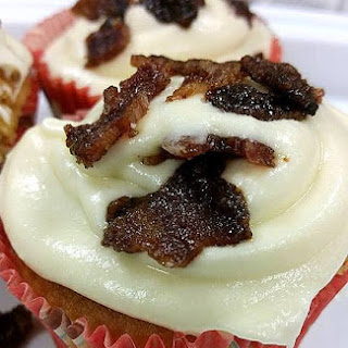Maple Flavored Cupcakes With Buttercream Frosting Topped with Candied Bacon.
