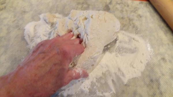 Spread some of the baking mix on your work surface. You can use a...