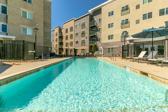 Community pool next to apartment buildings