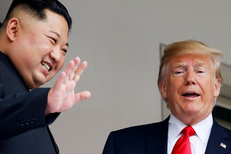 North Korean leader Kim Jong-un and US President Donald Trump react at the Capella Hotel on Sentosa island in Singapore on June 12 2018. Picture: REUTERS/JONATHAN ERNST