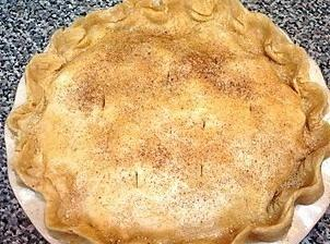 Place the second pie crust on top of the pie and fold the top...