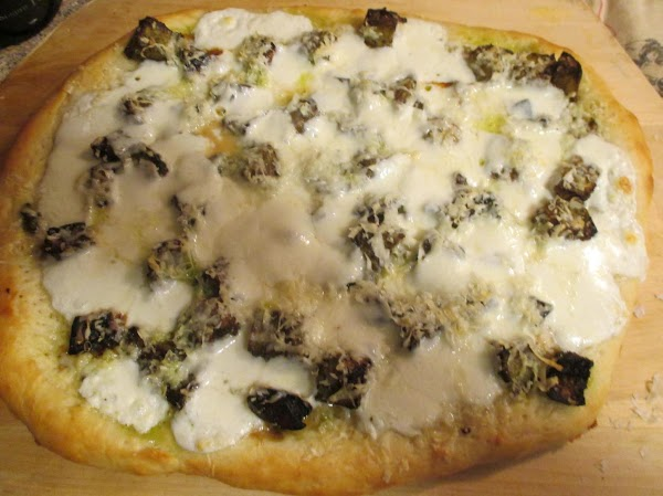 Brush olive oil on the edge of the pizza to get a lovely golden...