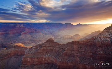 Photo: First Light, The Grand Canyon, Arizona#landscapephotography  #photographyworkflow  #photographytips BEST VIEWED LARGEGrand Canyon is a fantastic place to photograph and where there is light like this stream down on the hills and valley below the sight gets even better. On this particular day a cloud bank was hanging around just at the right place to let a narrow beam of golden light light up the peaks of the mountains.How was this image created?I use an 0.9 Hard Edge GND Filter to balance the overall light between the sky and the ground. But even with the filter the right side of the sky was over exposed. So, I bracketed my shots and used our iHDR manual blending technique to bring out the details in highlights on the right.Enjoy and Share._________
