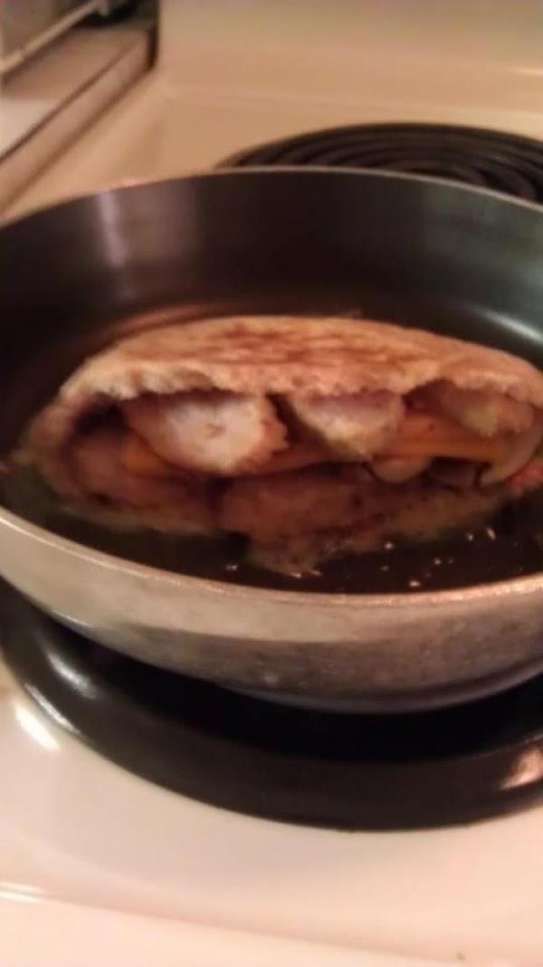 take  pan , add 1 tbsp butter , put the pita in pan,...