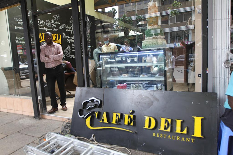 Cafe Deli owner Obado Obadoh outside one of his restaurants on Moi Avenue.