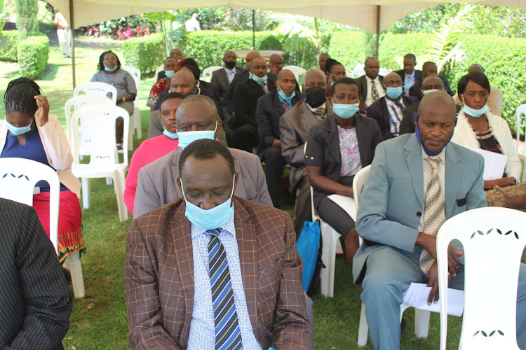 Members of Nyeri South Traders Sacco follow proceedings during the AGM in Othaya yesterday